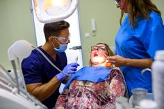 A patient getting attended and treatment in a dental studio Royalty Free Stock Photo
