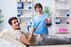 The patient getting blood transfusion in hospital clinic Stock Photography