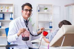The patient getting blood transfusion in hospital clinic. Patient getting blood transfusion in hospital clinic Stock Image