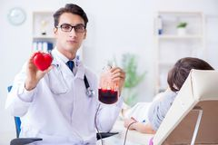 The patient getting blood transfusion in hospital clinic. Patient getting blood transfusion in hospital clinic Stock Photos