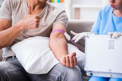 The patient getting blood transfusion in hospital clinic. Patient getting blood transfusion in hospital clinic Royalty Free Stock Photography