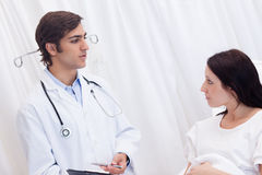 Patient getting examination results explained by doctor Stock Photos