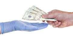 Patient Giving Doctor Money. Representing Rising Healthcare Costs Royalty Free Stock Images