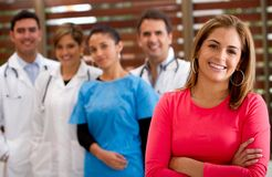 Patient with a group of doctors Stock Photos