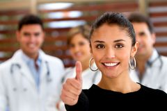 Patient with a group of doctors Stock Images