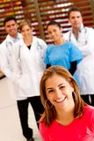 Patient with a group of doctors Royalty Free Stock Photo