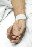 Patient hand with an intravenous drip Royalty Free Stock Photos