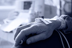 Patient hand with needle for intravenous dropper Stock Images