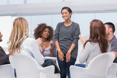 Patient has a breakthrough in group therapy. And everyone is clapping her royalty free stock photo
