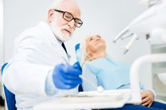 A patient having appointment with experienced dentist Royalty Free Stock Image