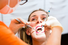 Patient having deep dental tooth cleaning Royalty Free Stock Image
