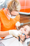 Patient having dental tooth cleaning Royalty Free Stock Images