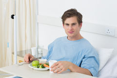Patient having meal on hospital bed Stock Images