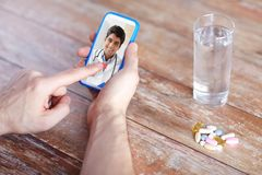 Patient having video chat with doctor on cellphone royalty free stock photos