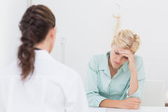 Patient with headache visiting doctor Stock Image