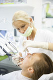 Patient and her dentist, doing a regular checkup Royalty Free Stock Photography
