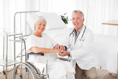 Patient with her doctor looking at the camera Stock Photography