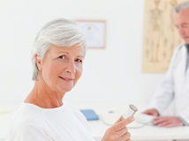 Patient with her pills Stock Image