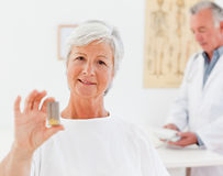 Patient with her pills Royalty Free Stock Image