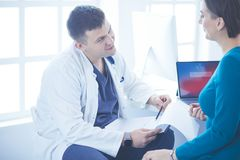 The patient and his doctor in medical office royalty free stock photo