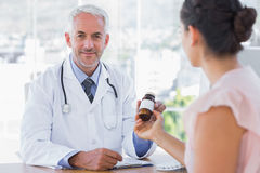 Patient holding a bottle of pills Royalty Free Stock Images
