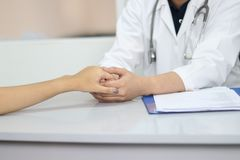 Doctor and patient in medical office. stock photo