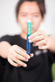 Patient holding insulin pen Royalty Free Stock Photography