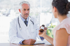 Patient holding jar of medicine Stock Photo