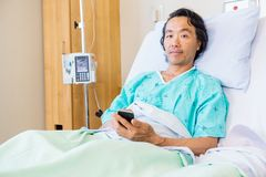 Patient Holding Mobile Phone While Resting On Royalty Free Stock Photo