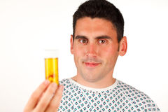 Patient holding pills and smiling Royalty Free Stock Image