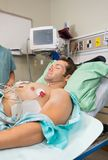 Patient With Holter Monitor Stuck To Chest Stock Images
