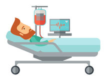 Patient in hospital bed being monitored Stock Photo