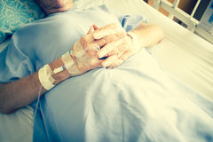Patient In Hospital Bed And Having Iv Solution Drop Stock Photo