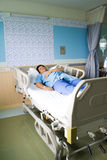 Patient in hospital bed Royalty Free Stock Image