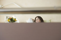 Patient In Hospital Bed Seen Through Bed Handle Royalty Free Stock Photos
