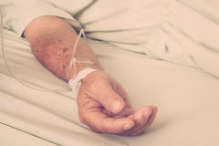A patient in the hospital with saline intravenous Stock Photos