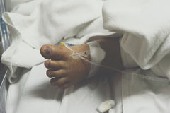 Patient in the hospital with saline intravenous Stock Images