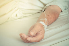 A patient in the hospital with saline intravenous , vintage styl Royalty Free Stock Photography