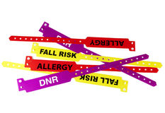 Patient ID Wristbands. A collection of patient cautionary ID wristbands including Allergy, Fall Risk and DNR on white background royalty free stock photos