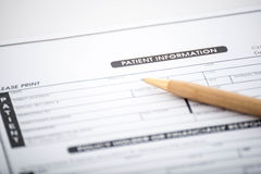 Patient information form and pen on desk,Medical questionnaire Royalty Free Stock Photo