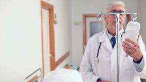 Patient with intravenous drip bag Stock Photo