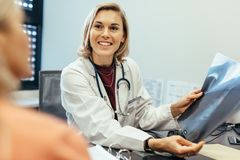Patient involvement in decision making with doctor Royalty Free Stock Image