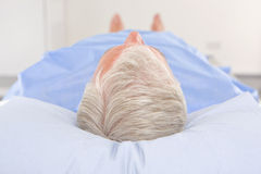 Patient laying on examination table in hospital Royalty Free Stock Photo