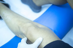 Patient leg in physical therapy physiotherapy Stock Photography