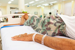 Patient lie on bed in emergency room Stock Photos
