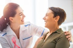Patient listening to doctor Stock Image