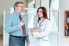 Patient listening to his doctor in medical office Royalty Free Stock Photos