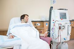 Patient Listening To Music While Receiving Renal royalty free stock photo