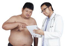 Patient looking at the check up result Stock Photos