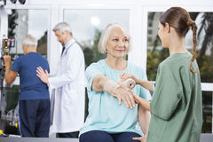 Patient Looking At Nurse Putting Crepe Bandage On Hand royalty free stock images